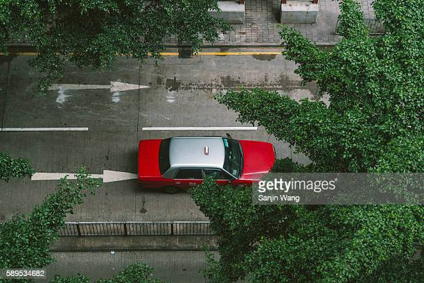 A overlooking of a red taxi in Hong Kong