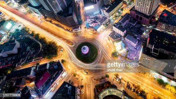 overlooking the city street directly above at night - road junction stock pictures, royalty-free photos & images