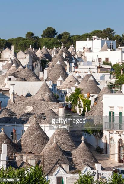 overlooking the conical roofs of the trulli, rione monti district, alberobello, apulia, italy - alberobello stock photos and pictures
