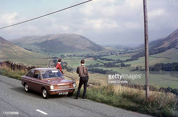 Overlooking the Lune Gorge in pre-motorway days,with my two friends, Chris & Stuart on 27/8/67. The car is my Hillman Imp Californian , just 2 months...