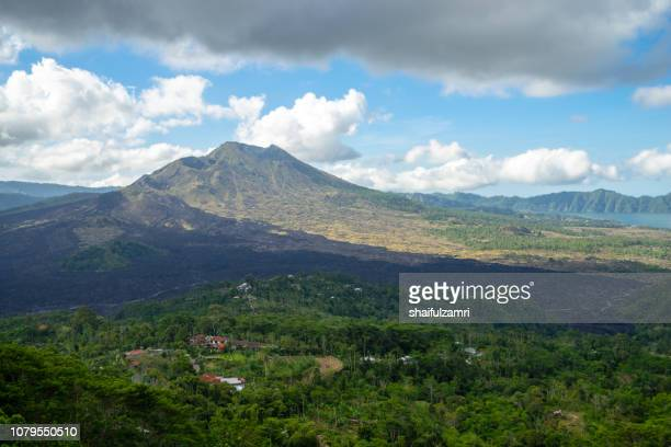 overlooking the mount batur at kintamani, one of popular tourist attraction on bali island - shaifulzamri stock pictures, royalty-free photos & images