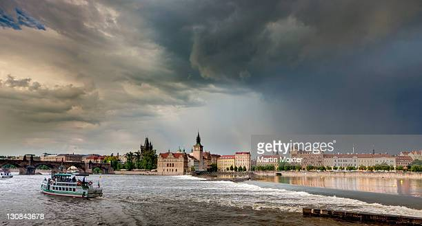 Overlooking the River Vltava in a thunderstorm and rain, Charles Bridge, Smetana Museum, a former waterworks, the Old Town Bridge Tower, Water Tower, dome of the Kostel sv. Frantiska church, Prague, Bohemia, Czech Republic, Europe