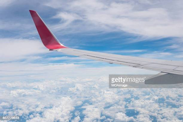 overlooking the scenery through the window on the plane - aircraft wing stock pictures, royalty-free photos & images