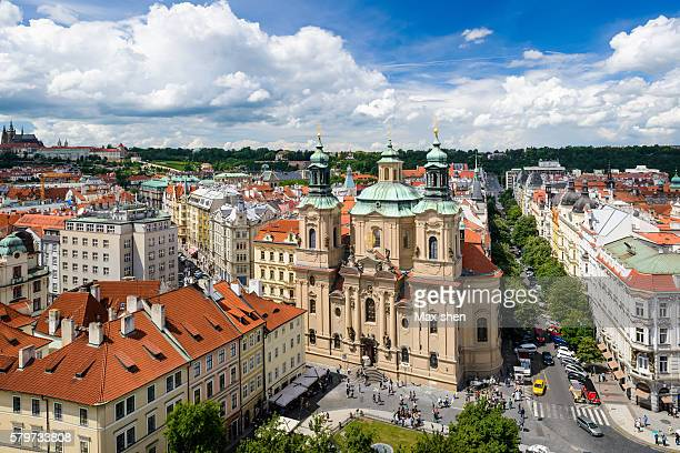 overlooking view of the st. nicholas church at old town square in prague - st nicholas' church stock pictures, royalty-free photos & images