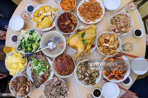 overlooking view of the typical chinese feast on the table. - banquet stock pictures, royalty-free photos & images