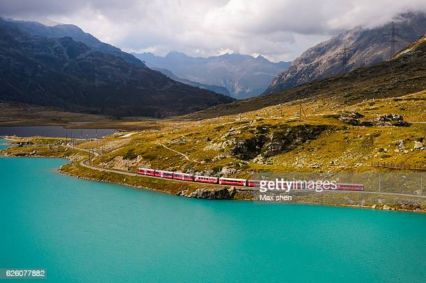 Overlooking view of train running on the Bernina railway in Switzerland.