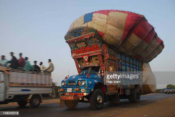 overly loaded truck - over burdened stock pictures, royalty-free photos & images