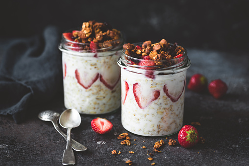 Overnight oats with strawberries and granola in jar - gettyimageskorea