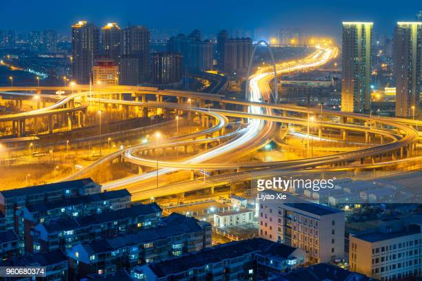 overpass and residential building - liyao xie stock pictures, royalty-free photos & images