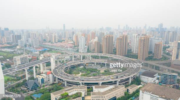 overpass and residential district - liyao xie stock pictures, royalty-free photos & images