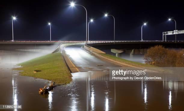 overpass ramp covered by water during flood - extreem weer stockfoto's en -beelden