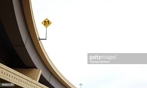 Overpass with merge sign