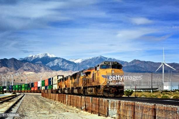overseas cargo containers on freight train - palm springs, california, usa - railroad stock photos and pictures