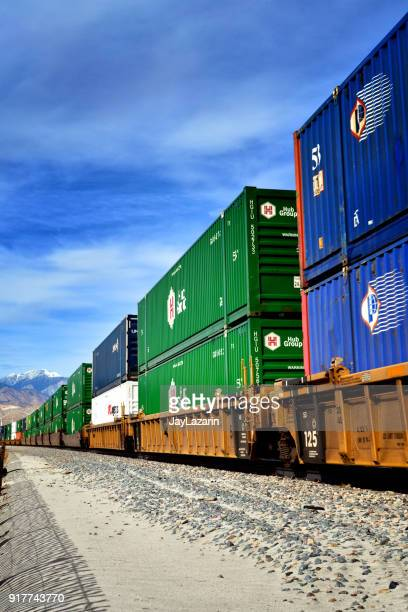 overseas cargo containers stacked on freight train, palm springs, california, usa - moving past stock photos and pictures