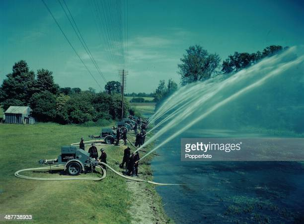 1944 Overseas contingent of the National Fire Service employed during World War Two Firemen undergoing training with heavy duty hoses England June...