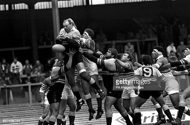 Overseas XV's Andy Haden drops the ball at a line out as he is assisted by teammates Enrique Rodriguez and Flippie Van Der Merwe