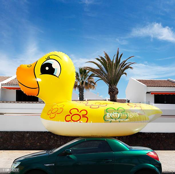 Oversize inflatable beach toy on car roof