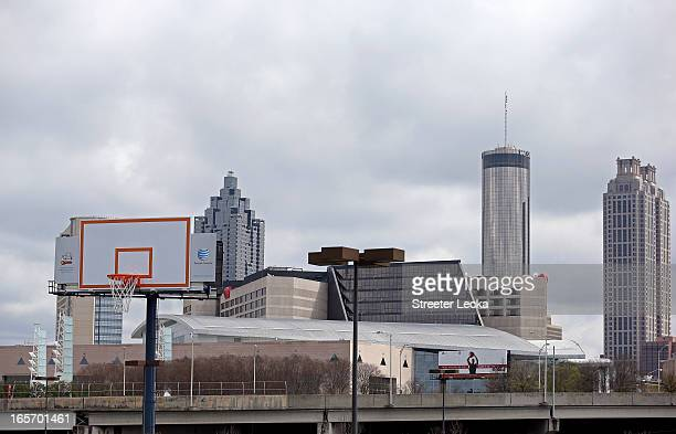 A oversized backboard and basketball hoop are seen on a billboard infront of the Atlanta City skyline during practice prior to the NCAA Men's Final...