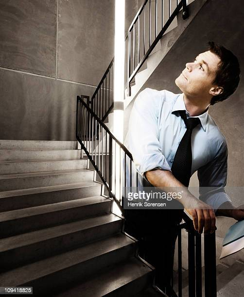 Oversized businessman on staircase