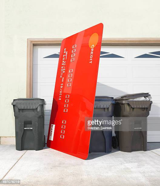Oversized credit card put out with trash