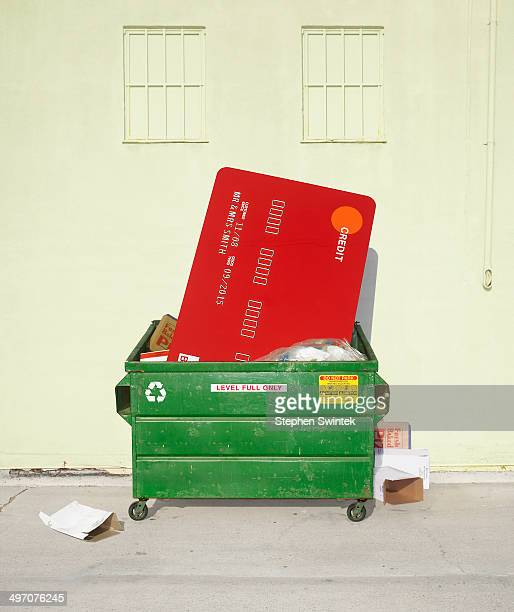 Oversized credit card stuffed in dumpster