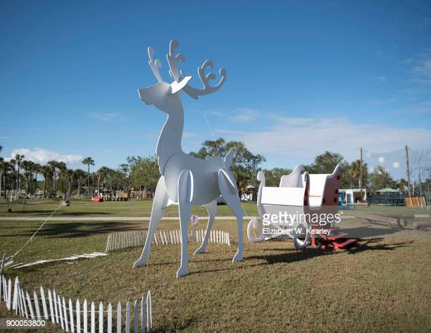 oversized reindeer and sleigh - florida christmas stock pictures, royalty-free photos & images