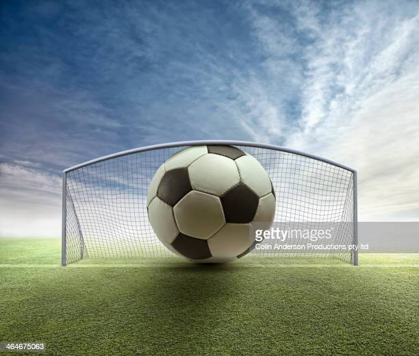 oversized soccer ball stuck in goal - exceed and excel stock pictures, royalty-free photos & images