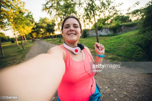 oversized woman selfie at running - selfie stock pictures, royalty-free photos & images