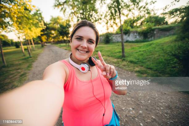 oversized woman selfie at running - big fat women stock pictures, royalty-free photos & images