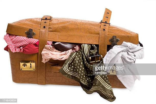 overstuffed brown textured luggage - stuffing stock photos and pictures
