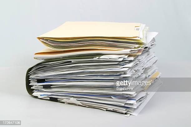 overstuffed file folders document paper portfolio - briefcase stock photos and pictures