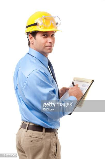 Over-the-shoulder view of contractor in hard hat