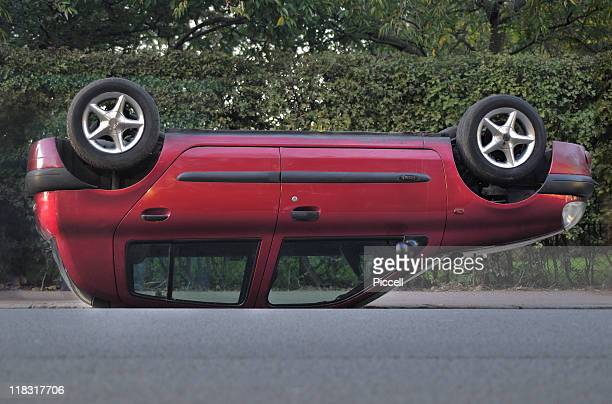 overturned car in street - upside down stock pictures, royalty-free photos & images