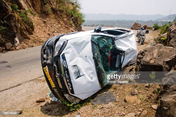 CONTENT] Overturned car on mountain road in Kashmir The car is an Indianmade TATA Indica DLE The car rolled over and hit the rocks Amazingly the 4...
