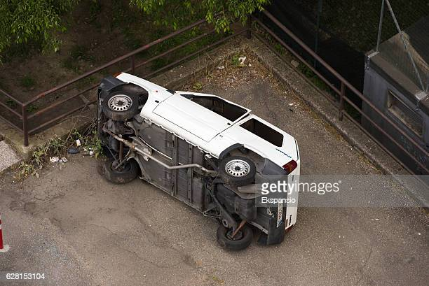 overturned fiat panda after a joyride car accident - abandoned car stock photos and pictures