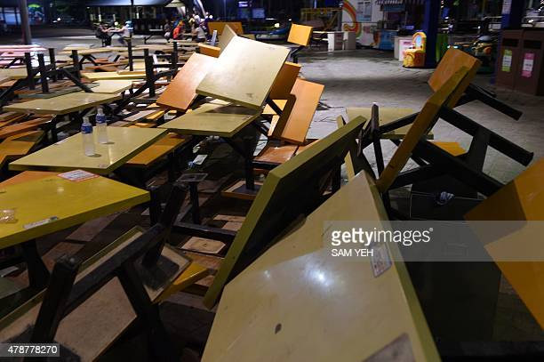 Overturned tables lie on the ground at the Formosa Fun Coast amusement park after an explosion in the Pali district of New Taipei City early June 28,...