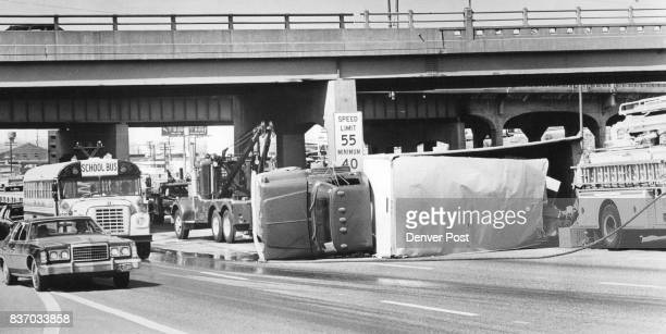 Overturned Truck ties up traffic Traffic on Interstate 25 creeps past a truck lying on its side near the West Colfax Avenue overpass after the truck...