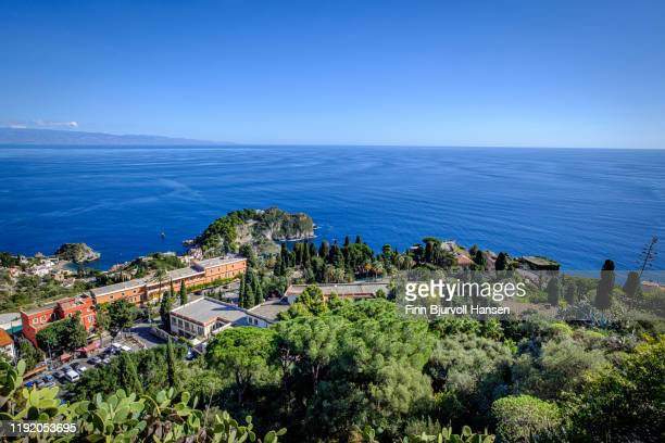overview from the edge of the greek theatre in taormina, mediterranian and calabria in the background - finn bjurvoll stock pictures, royalty-free photos & images
