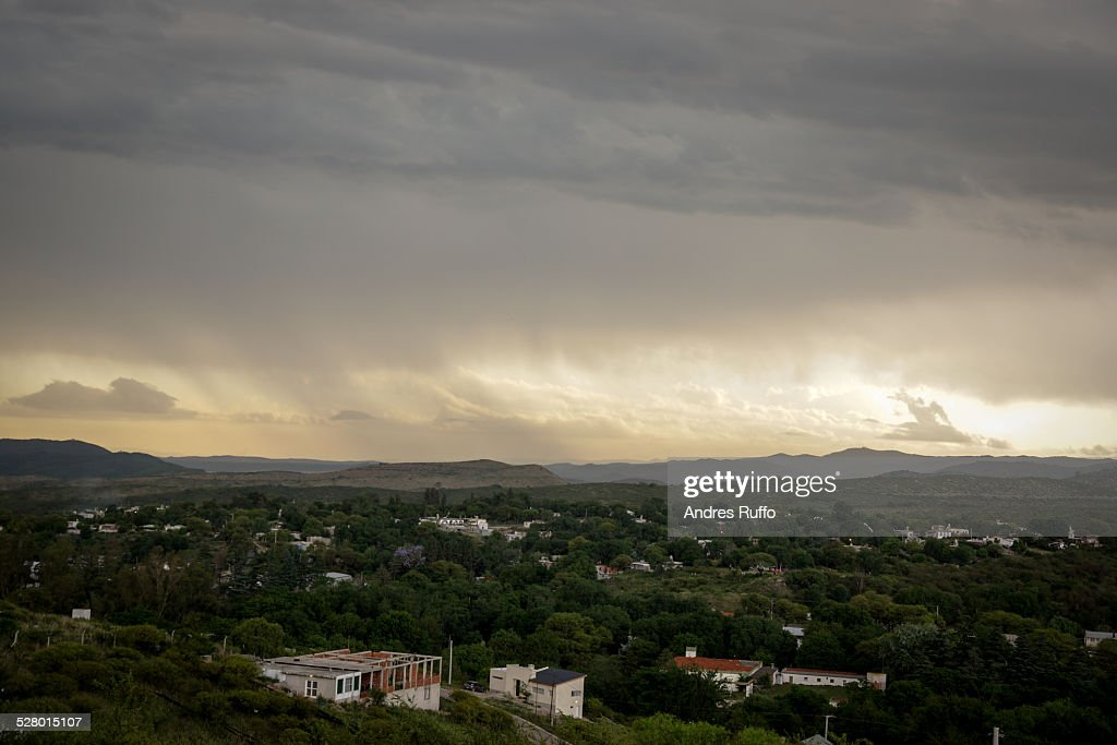 Overview of a summer storm raining on the mountain : Stock Photo
