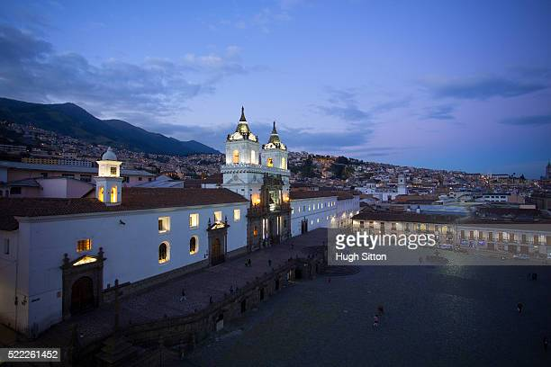 overview of city of quito at dusk, pichincha province, ecuador - hugh sitton stock pictures, royalty-free photos & images