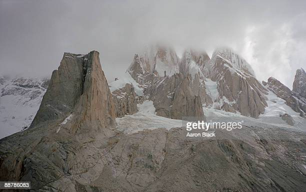 overview of famous mountain range in clouds