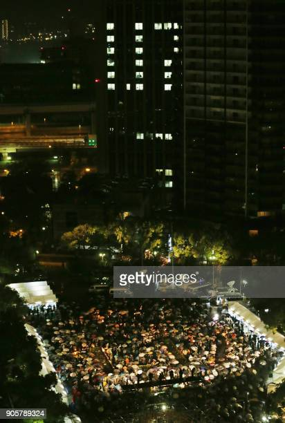 Overview of Kobe residents attending the 23rd memorial service for the January 17 1995 Great Hanshin earthquake victims at a park in Kobe Hyogo...