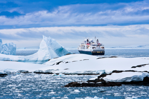 Overview of large cruise ship sailing through icy waters 148329826