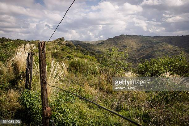Overview of mountains with perimeter wire fences