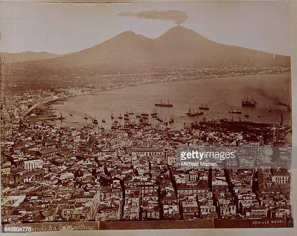 Overview of Naples intellectual and commercial center of southern Italy Mount Vesuvius volcano is in the background ca 1880s1890s