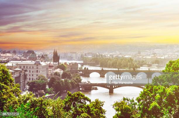 overview of prague and vltava river at sunset - prag stock-fotos und bilder