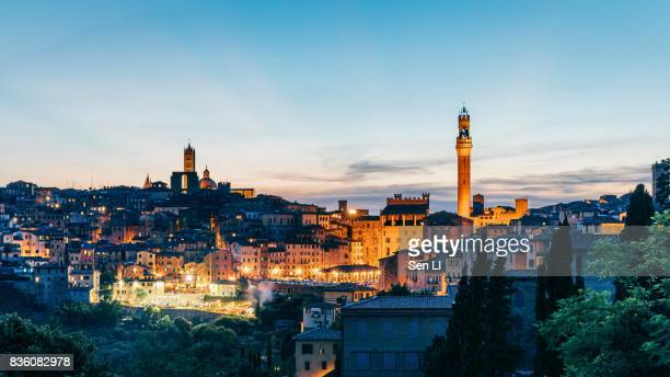 overview of siena city from distance - siena italy stock photos and pictures