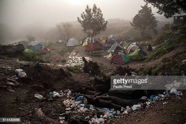 Overview of tents in the fog near a landfill in the camp of Idomeni the border between Gracia and Macedonia Migrants in the fog at camp of Idomeni in...