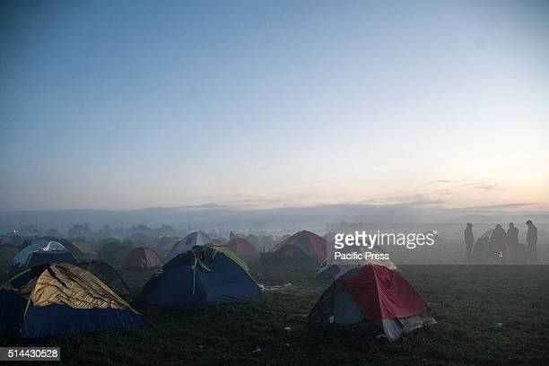 Overview of tents in the morning fog at the camp of Idomeni the border between Greece and Macedonia Migrants in the fog at camp of Idomeni in Greece...