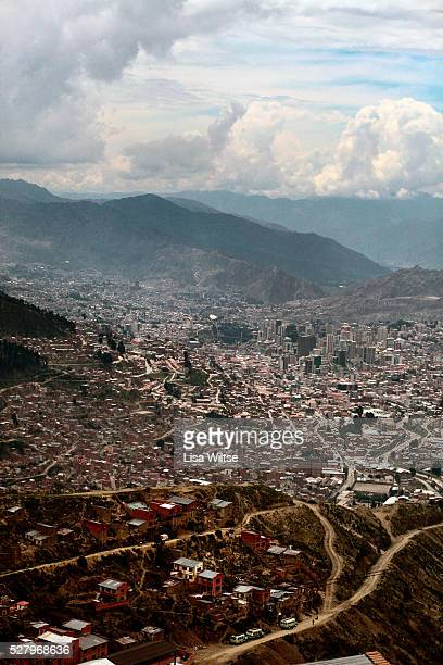 Overview of the capital city of Bolivia, seen from the cliffs of neighboring El Alto, and the crowded and packed city with its red orange brick walls...